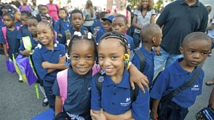 Second-graders Second-graders Nicole Hurt, left, and Aliya Holmes enjoy their first day of school at William F. Harrity Elementary School in Philadelphia. Harrity is one of three failing schools that has been taken over by Mastery Charter Schools.
