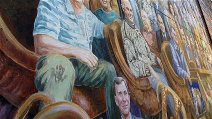 » See photo: PSU mural The mural from which artist Michael Pilato removed the image of former Penn State assistant coach Jerry Sandusky.