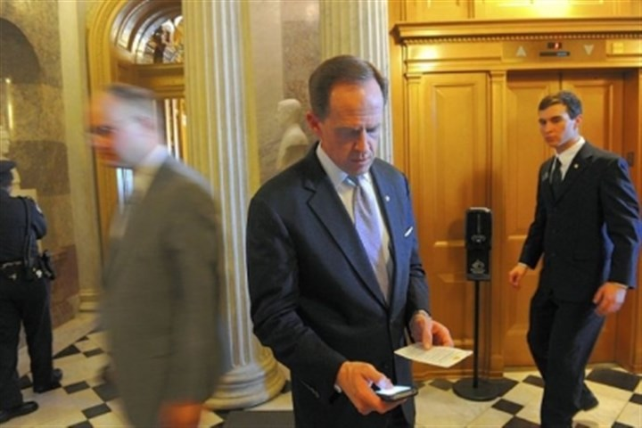 Sen. Pat Toomey checks his schedule Sen. Pat Toomey checks his schedule outside the Senate chambers in February.