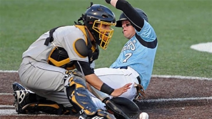 Seneca Valley's Carson Seneca Valley's Carson Kessler slides safely into home plate against North Allegheny's Justin Dattilo in the WPIAL class AAAA championship at Consol Energy Park Wednesday night.