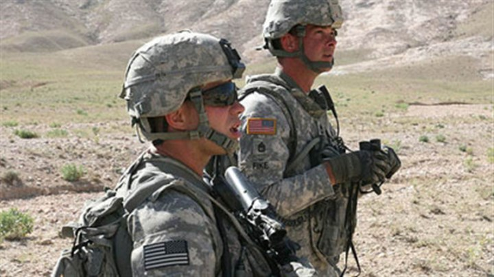 Sense of duty Sgt. Bryan A. Hoover, left, and Sgt. Robert J. Fike patrol in the Shajoy District of Zabul Province, Afghanistan. Both men died in a suicide bomb attack.