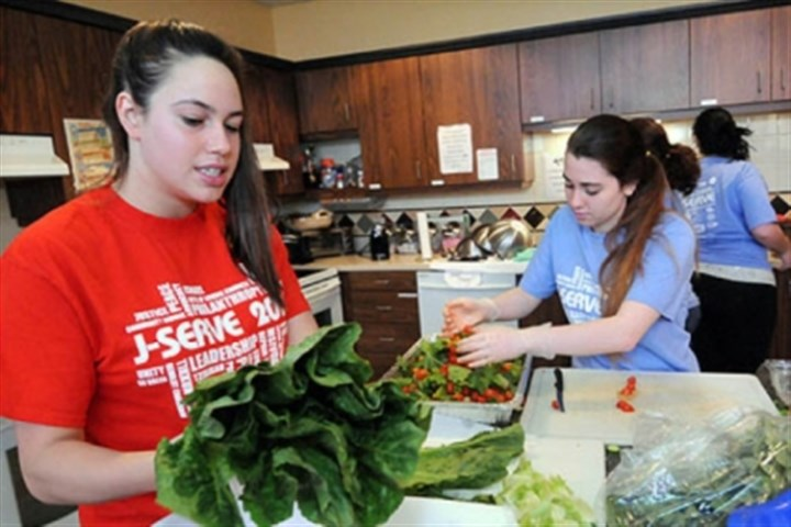 serve2 Destin Groff, left, and Hannah Frank prepare salad as teens participating the the seventh annual J-Serve day of service for Jewish youth prepare a lasagna meal at the Ronald McDonald House at Children's Hospital of Pittsburgh of UPMC.