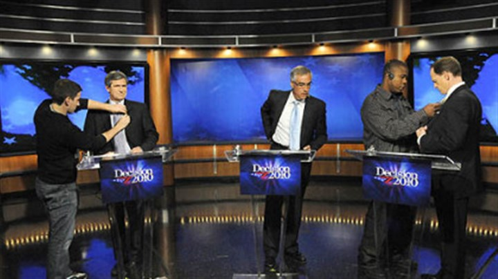 Sestak, Toomey debate Senate candidates Joe Sestak, left, and Pat Toomey, right, prepare for a debate moderated by David Johnson, center, at the WPXI studio Friday night.