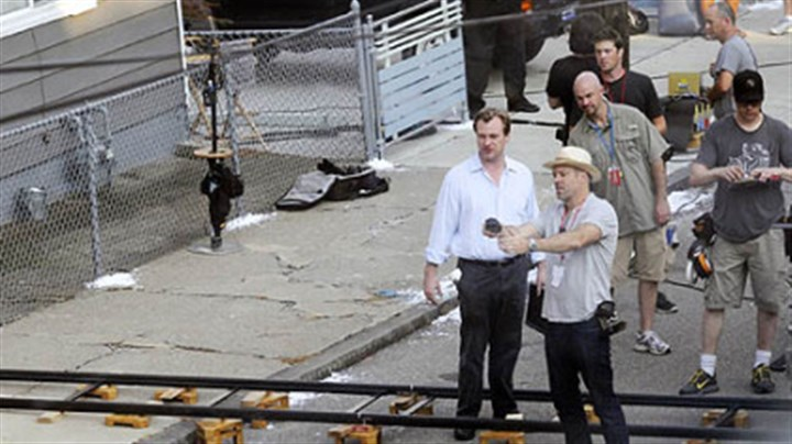 Setting up shots Christopher Nolan, left, sets up a scene with cinematographer Wally Pfister on 41st Street in Lawrenceville on Friday.