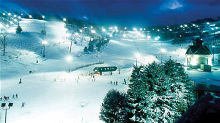 Seven Springs Bright lights and noisy snowmaking towers greet skiers and snowboarders as they head for the six-passenger Coco Cola Polar Bear Express lift at Seven Springs for an evening of fun on the slopes.