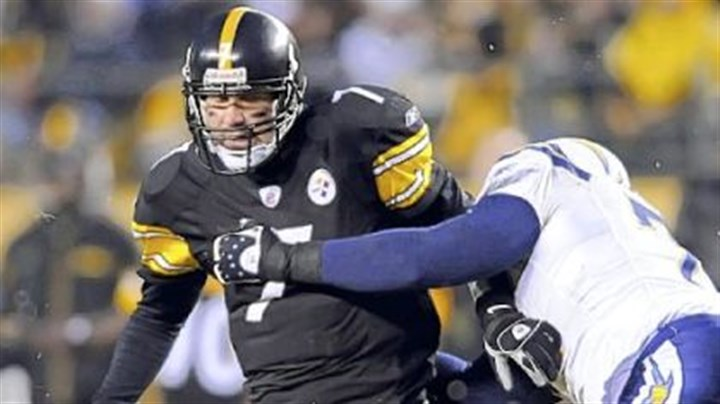 Shake off Ben Roethlisberger tries to shake off San Diego's Jacques Cesaire. Roethlisberger was sacked four times.