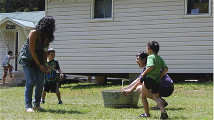 Shana Rose and children The National Youth Science Camp has been held at Camp Pocahontas, a 4H site, since 1963. Even playtime involves science as Shana Rose sprays friends with a