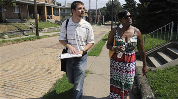 Sheraden 2 Steve Novotny, the Sheraden Community coordinator, and Tammy Thompson of NeighborWorks Western PA, go door-to-door giving out information in Sheraden on issues in the community, including foreclosures and other housing issues.