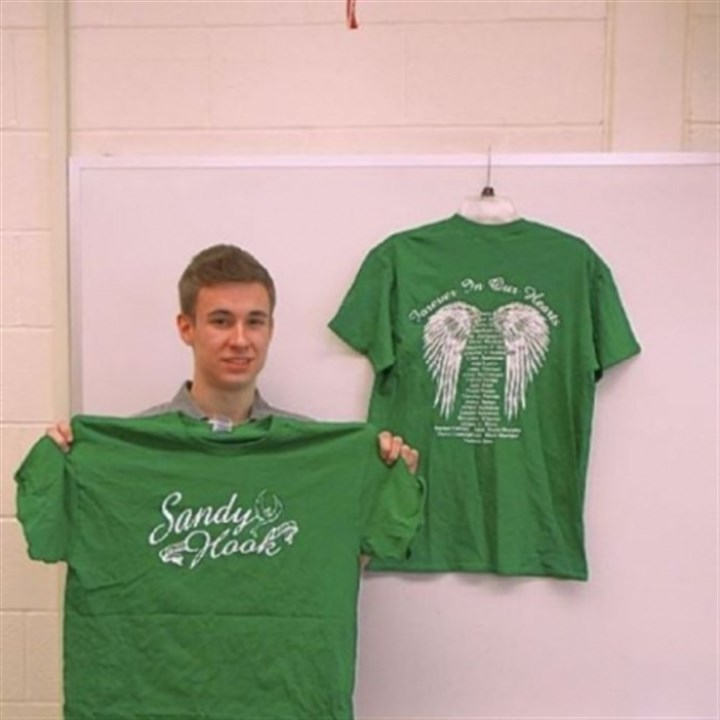 Shirts Sales of Noah Sims' T-shirts will benefit Sandy Hook Elementary School in Connecticut.