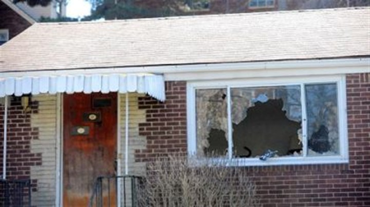 Shooting scene The front picture window is broken out at the Poplawski home at 1016 Fairfield St., Stanton Heights.