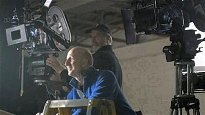 "Shooting ""The Road"" Director John Hillcoat, foreground, and Javier Aguirresa-robe, director of photography, on the set of ""The Road."""