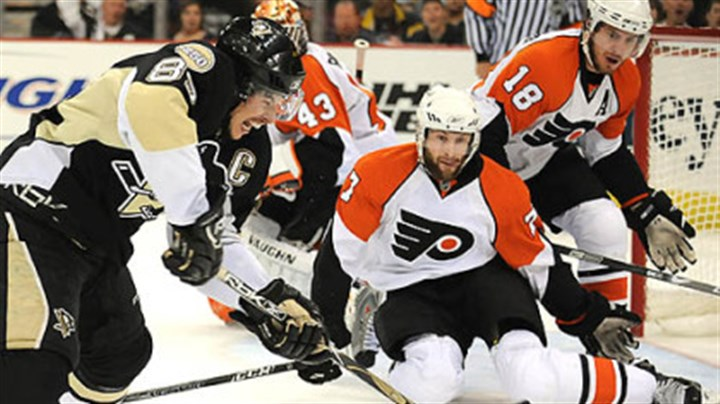 Sidney Penguins Sidney Crosby takes shot on Flyers goalie Martin Biron in the first period.
