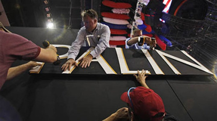 Sign work Workers put the finishing touches on a sign for Republican vice presidential candidate, Alaska Gov. Sarah Palin, at the Xcel Center before the first session of the Republican National Convention this week.