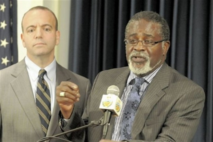 "simmons William ""Jack"" Simmons, right, director of Shuman Juvenile Detention Center, will serve a suspension."