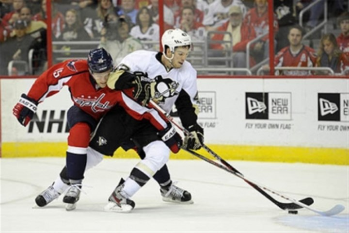 Simon Despres Washington Capitals right wing Joey Crabb battles for the puck against Penguins defenseman Simon Despres during the first period.