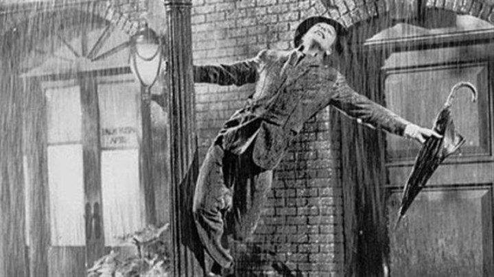 "Singin' in the rain The iconic photo of Gene Kelly in the 1952 film ""Singin' in the Rain."""