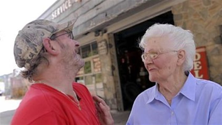 "Smiles Dorothy Genser jokes with Tom Ganster on June 19 outside the gas station that has been in her husband's family since 1928. Ms. Genser, who still works at the station, started at the gas station more than 70 years ago when her husband, Clarence, went to fight in World War II. She said she remembers a quieter time at the gas station. ""When you get old you like it to be quiet,"" she said. ""It's like a race now. People speed."""