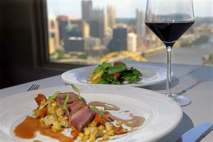 Smoked duck breast Smoked duck breast comes with chanterelle mushrooms, bicolored corn, black pepper cavatelli and micro cilantro.