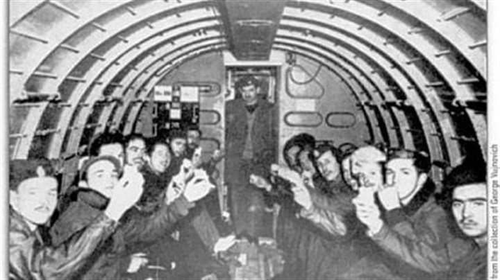 Snacktime on flight from Pranjane American fliers enjoy a snack on a C-47, on the way from Pranjane, Yugoslavia, to Bari, Italy.