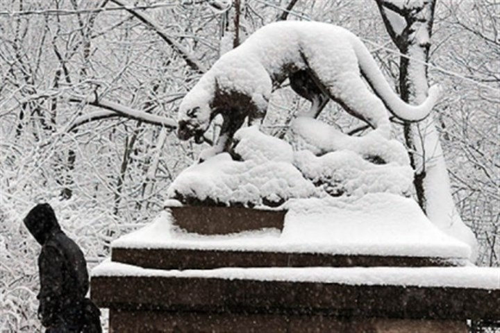 Snow panther Snow covers the panther statues at the Panther Hollow Bridge in Schenley Park early wednesday morning.