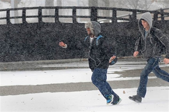 snow running point state park Patrick Terry and Eli McCary walk through the snow at Point State Park during today's snowfall