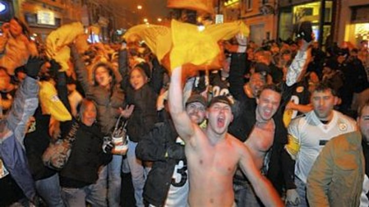 Some really happy Steelers fans Fans fill the 1500 block of East Carson Street on the South Side last night after the Steelers defeated the Baltimore Ravens to go to the Super Bowl.