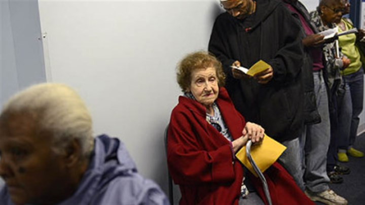 Sophie Sophie Masloff, 94, of Squirrel Hill, a former mayor of Pittsburgh, waits in line with others for voter identification Monday evening at the CCAC Homewood-Brushton Center. A judge ruled this morning to toss out a portion of the law.