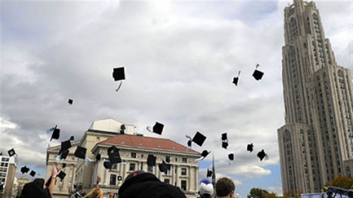 "'Sorority Row' Actors and extras toss their mortarboards into the air while filming ""Sorority Row"" yesterday near the Cathedral of Learning in Oakland."