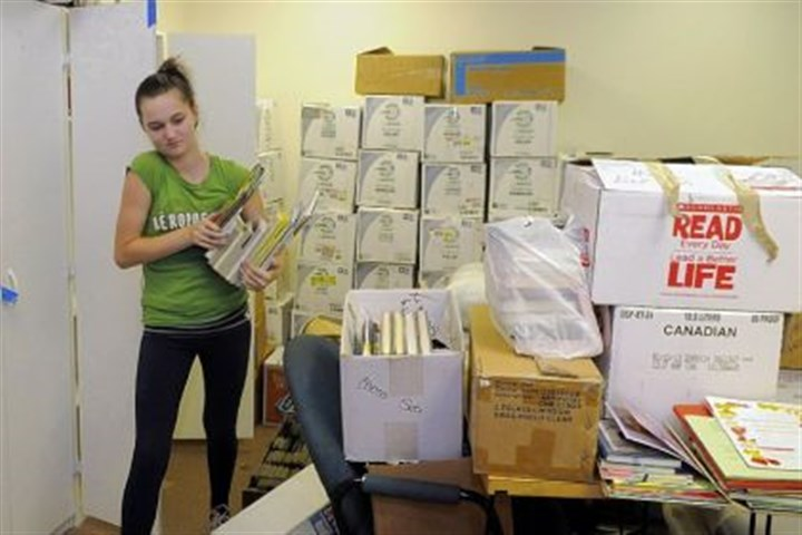 Sorting books Brianna Watters, 13, helps sort books at the new Western Allegheny Community Library in North Fayette.