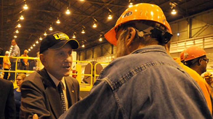 "Specter at Irvin plant Steelworker Don ""Bear"" Walko, of Belle Vernon, talks with Sen. Arlen Specter at U.S. Steel's Irvin plant in West Mifflin on Thursday."