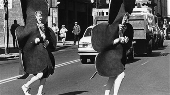 St. Patrick's Day Parade 1987 Linda Scharf, left, of Bellevue and Nancie Magnuson of Rosslyn Farms fight a brisk wind and non-aerodynamic shamrock costumes to cross Smithfield Street, Downtown at the 1987 St. Patrick's Day parade.