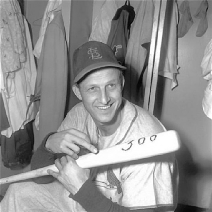 StanMusial Stan Musial of the St. Louis Cardinals holds bat with which he hit his 300th major league home run in 1955.