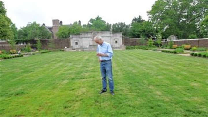 "Stars in Mellon Park Joe Seamans of Point Breeze examines a ""star"" embedded in the lawn at Mellon Park Walled Garden in Shadyside."