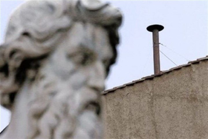 statue dwarfs A statue dwarfs the chimney on the roof of the Sistine Chapel, where cardinals will gather today to elect the new pope during the conclave at the Vatican.