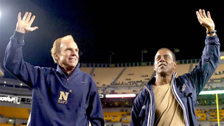 Staubach and Dorsett Heisman Trophy winners Roger Staubach, left, and Tony Dorsett wave to the crowd before Pitt's 2007 game against Navy at Heinz Field.