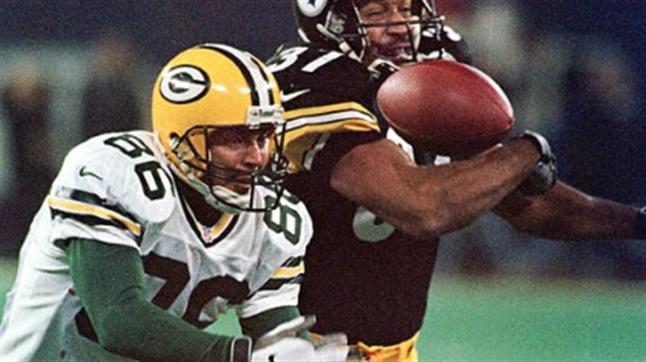 Steeler Carnell Lake Steelers cornerback Carnell Lake reaches for a pass tipped by Green Bay Packers Antonio Freeman, 1998.