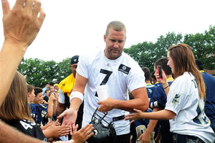 Steelers Ben Roethlisberger greets fans Ben Roethlisberger greets fans Saturday as he heads to practice at training camp.