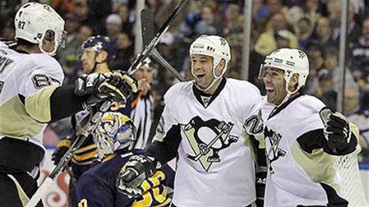 Steve Sullivan celebrates The Penguins' Steve Sullivan celebrates his goal with teammates Sidney Crosby and Pascal Dupuis on Buffalo Sabres goalie Ryan Miller during the second period of tonight's game in Buffalo, N.Y.