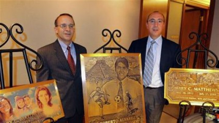 Steven Nicola and Joseph Bartolacci Steven Nicola, chief financial officer of Matthews International Corp., and Joseph Bartolacci, president and CEO, stand with some of the bronze plaques made with their digital technology.