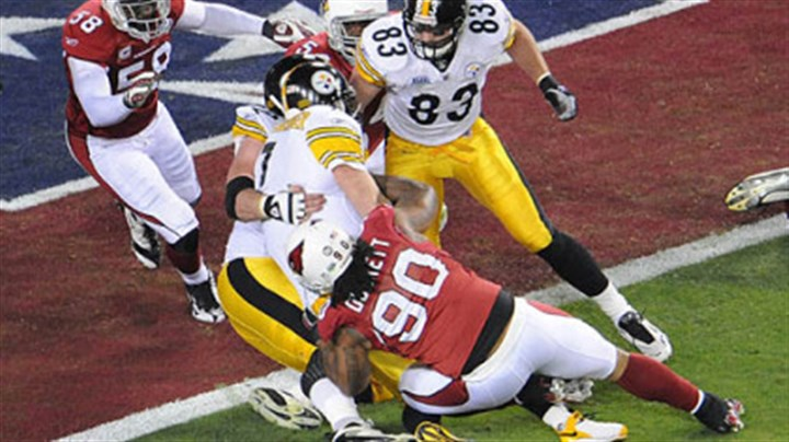 Stopped short Ben Roethlisberger is stopped short of the goal by Cardinals' Calais Campbell, left, and Darnell Dockett, bottom, in the first quarter tonight at Super Bowl XLIII.