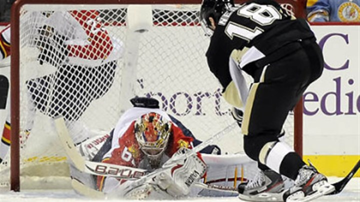 Stops the shot Florida's Jose Theodore stops a shot by Penguins James Neal in the second period at Consol Energy Center Friday.
