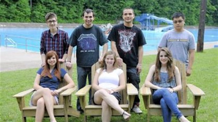 Students Students in Mike Magri's Technology Club from Keystone Oaks High School pose with the Adirondack chairs they made and donated to the Dormont Pool earlier this month.