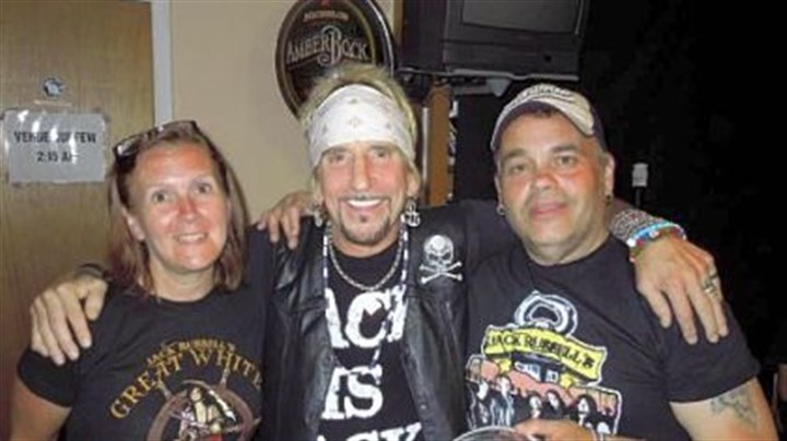 Sue Hetzer, Jack Russell and Lou Hetzer Jack Russell of Great White (center) with promoter Lou Hetzer and Lou's wife, Sue.