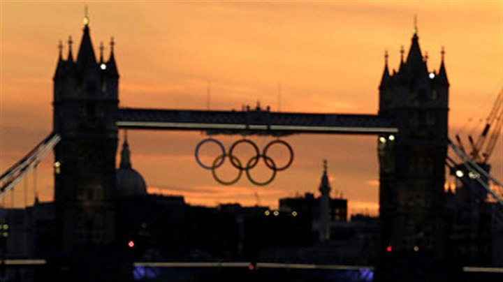Sunset London The sun sets behind London's landmark Tower Bridge with a display of Olympic rings in the distance on Saturday, July 21, 2012, in London. The 2012 London Olympics open this Friday.