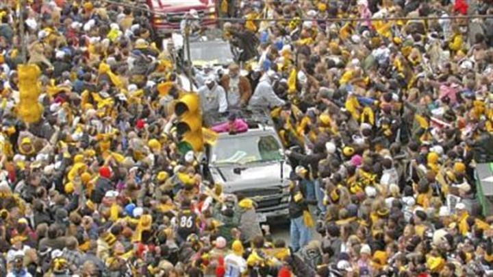 Super moment Ben Roethlisberger and Charlie Batch, in the first truck in foreground, ride through a sea of fans lining Fifth Avenue during the Steelers Super Bowl XL Victory Parade in 2006.