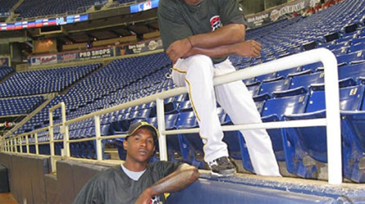 Superman vs. the Flash? Pirates outfielders Nyjer Morgan, below, and Andrew McCutchen at the Metrodome in Minneapolis.