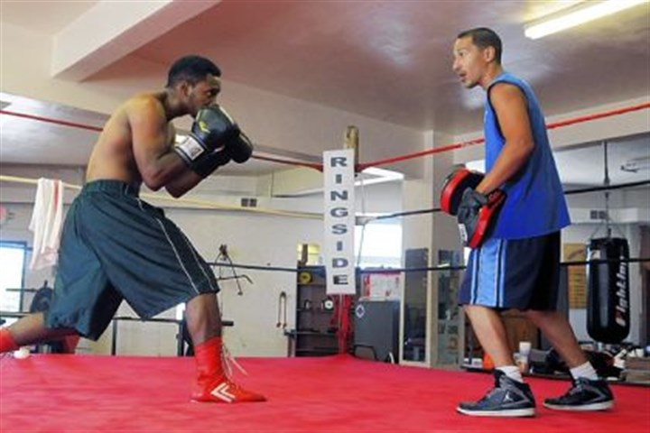 sydnor spar Eric Sydnor, left, spars with Jose Caraballo in a focus mitts exercise at the Ray Schafer Boxing Association in Sharpsburg.