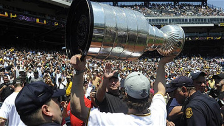 Take me out to the ball game The PNC Park crowd erupts as Sidney Crosby hoists the Stanley Cup before the game against the Tigers yesterday, Many members of the NHL champion Penguins attended the game.