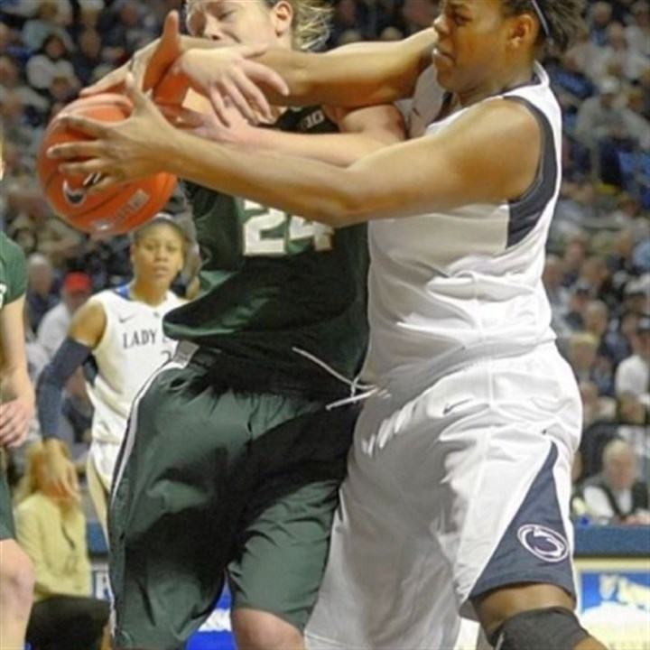 TaliaEast Penn State's Talia East, right, reaches past Michigan State's Courtney Schiffauer for a rebound in the first half Sunday in University Park, Pa.
