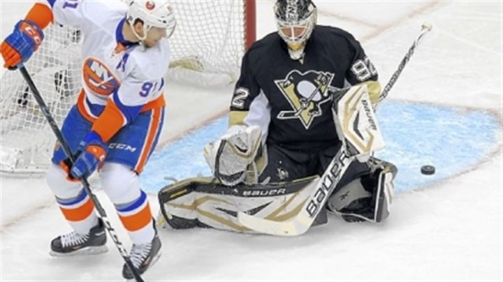 tavares Penguins goaltender Tomas Vokoun makes a save against New York's John Tavares in the first period of Game 5 Thursday night at Consol Energy Center.